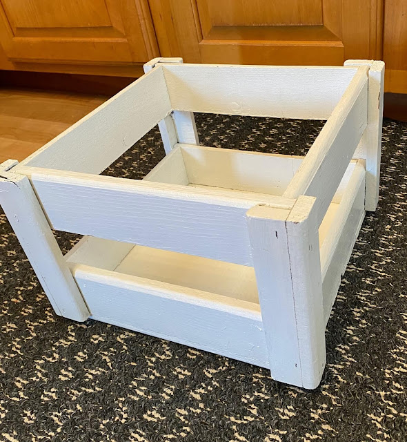 Photo of a white painted small open crate
