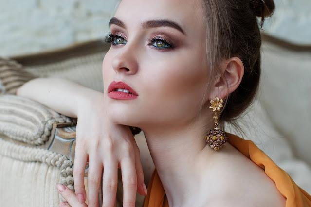 Pretty woman modeling jewelry.