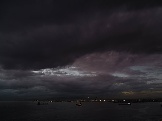 Very dark clouds over the Port of Gibraltar after sunset.