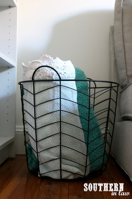 Spare Bedroom to Home Office Makeover on a Budget - Unique Home Office Ideas and How To's - Wire Blanket Basket Storage with Throw Rugs