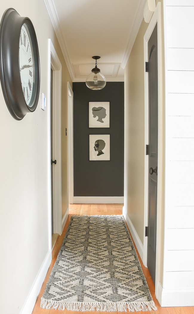 Dark hallway with black and white Emerson rug