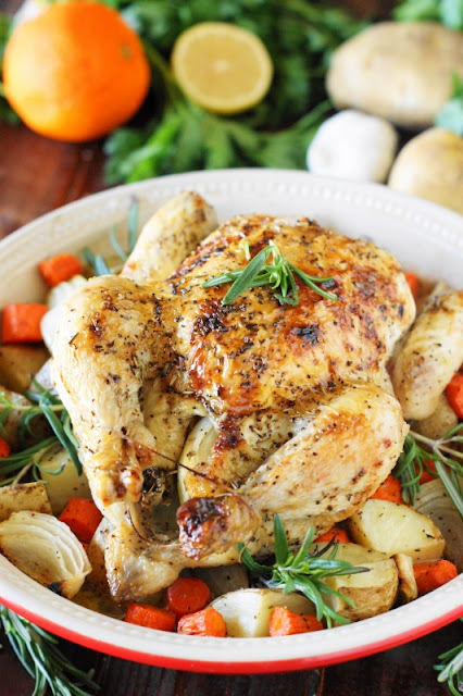 Whole Roasted Chicken with Vegetables ~ A meal perfect for a casual weeknight family dinner, or for company alike.  Pop vegetables in the bottom of the pan, and you've got a totally delicious, easy side to serve up, too.  www.thekitchenismyplayground.com