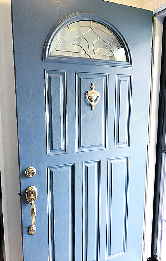 blue door with arched window