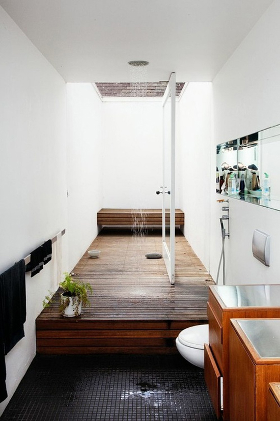 A long decked shower that brings the outdoors inside (found via Remodelista)