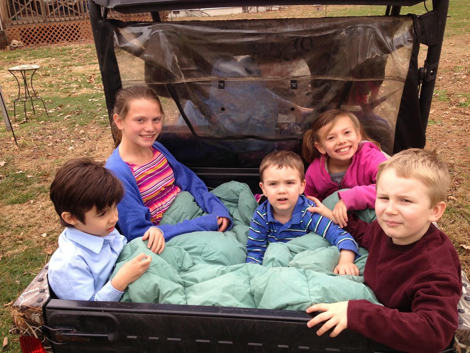 off-road vehicle, kids smiling, farm