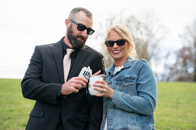 Bride and Groom cheering their bud light and travel flute with sunglasses on Magnolia Farm Asheville Wedding Photography captured by Houghton Photography