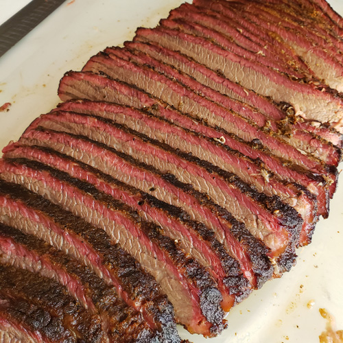 Sliced smoked brisket flat with a beautiful smoke ring