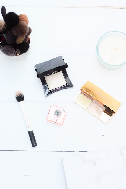 A flat-lay of Sleek Makeup, Illamasqua and Benefit Highlighters
