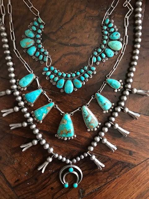 Silver necklace with turquoise stones.