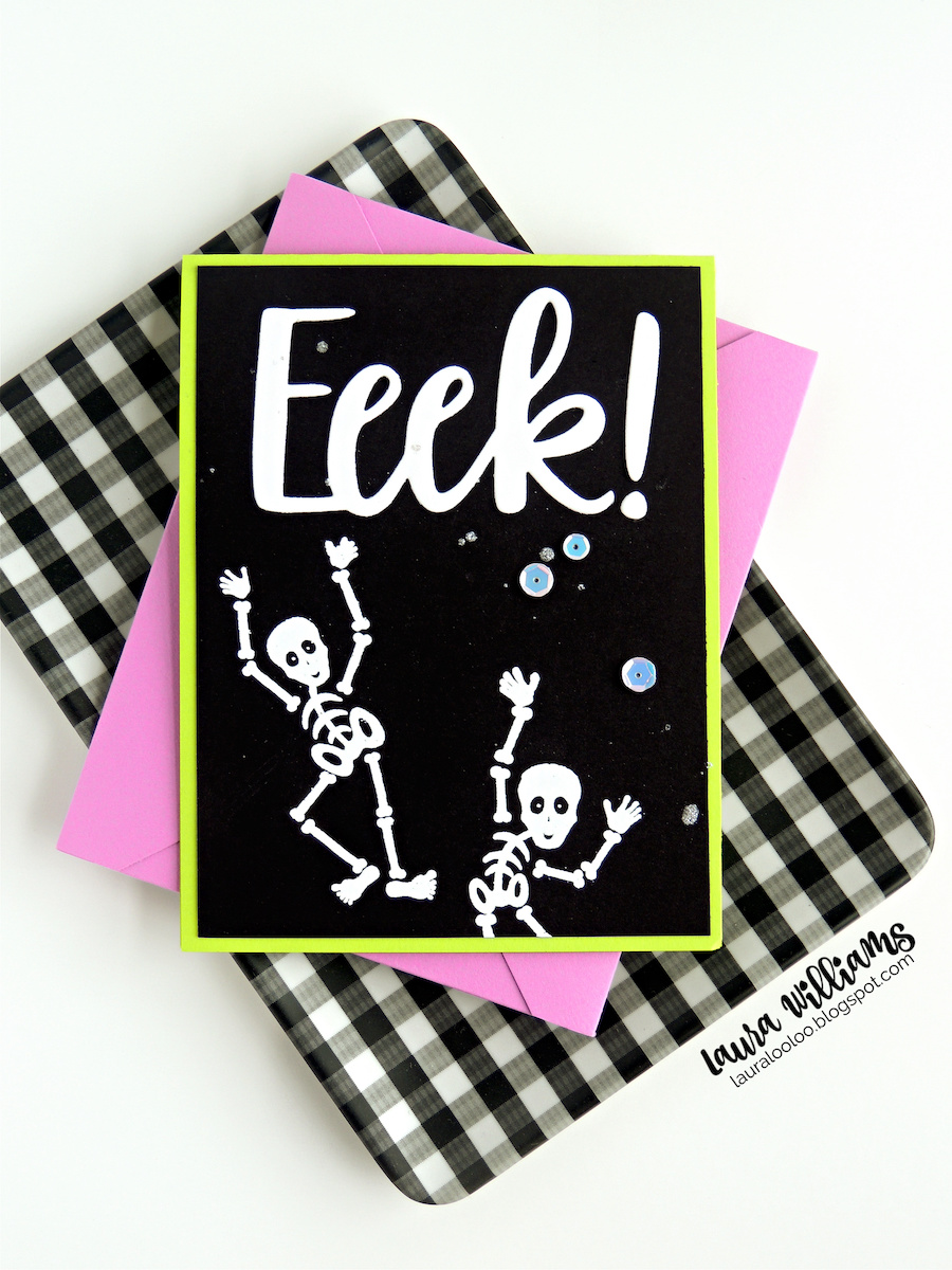 """A handmade Halloween card that is black with a lime green border. There are two stamped skeletons that are embossed in white. There is a large die cut sentiment, from white cardstock, that says """"Eeek!"""" There are white iridescent sequins scattered across the Halloween card. The stamps and dies are from Impression Obsession. In this photo, the card is resting on a purple envelope, and a black & white gingham tray."""