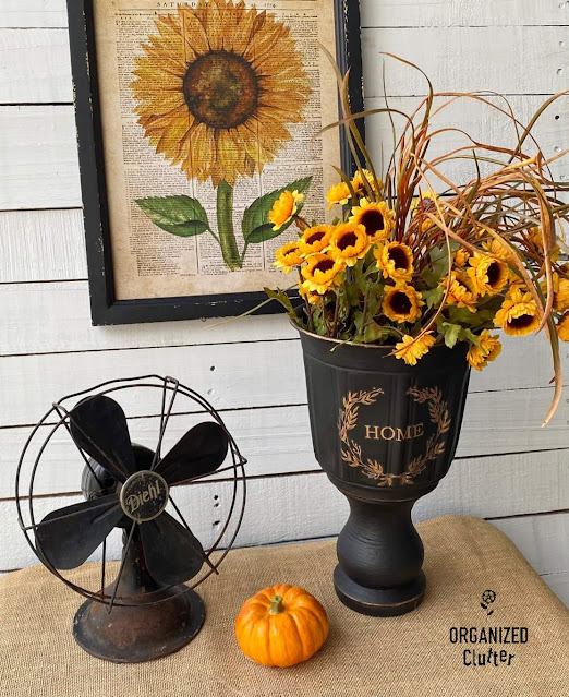 Photo of a black DIY urn with fall decor