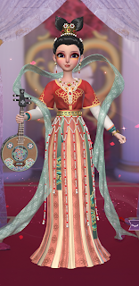 Red beaded dress with musical instrument accessory and hair that resembles a mermaid tail