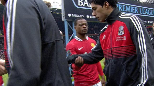 Evra finally squashes beef with Suarez, congratulates him on Golden Boot award