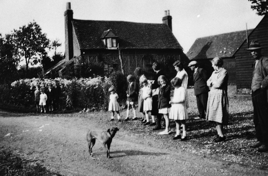 Photograph of Shadbolt and Brown families at Marshmoor Farm cottages. 1950s