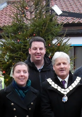 Brigg and Goole MP Andrew Percy, centre, with the Rev Trudy Hobson and Town Mayor Coun Donald Campbell after the Tree of Light's closing ceremony in Chapel Court on January 5, 2019