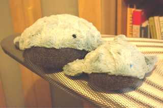 2 whale plushies sat next to each other