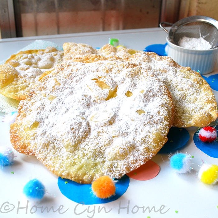 Merveilles are thin crispy disks of fried eggy dough dusted with sugar