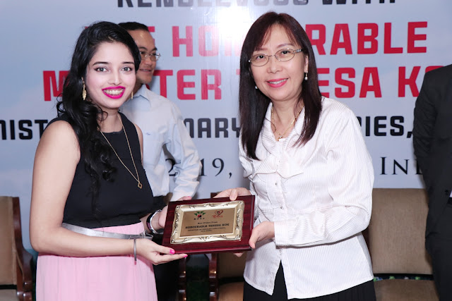 Nikita Gharat receiving the award from Teresa Kok Ma'am at Tajlands end
