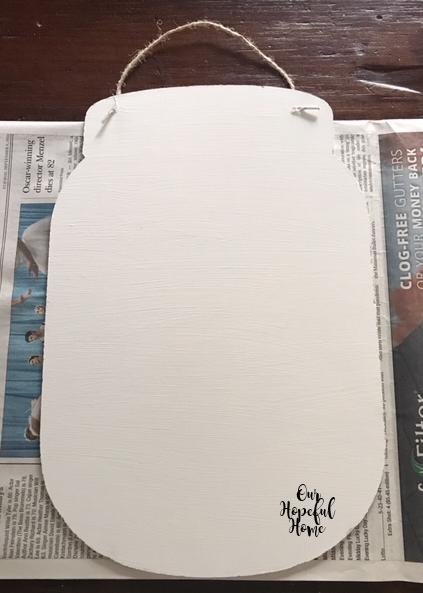 white painted mason jar sign