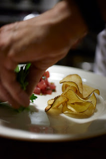 Tuna Tartare with Serrano Chillies, Shalots and Fresh Baked Chips.