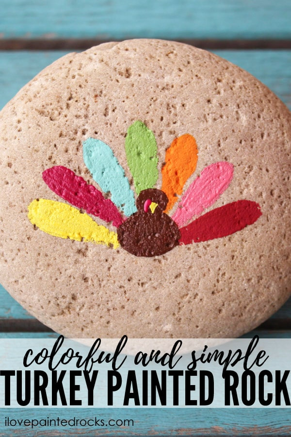 How to paint a simple turkey rock with colorful feathers perfect for a Thanksgiving tablescape.