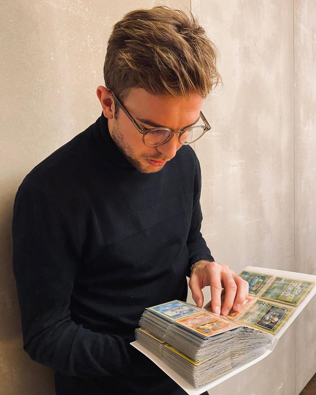 Germany and Borussia Mönchengladbach midfielder Christoph Kramer shows off his full set of all 151 original Pokémon cards