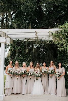 bride and bridesmaids in neutral dresses
