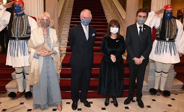 Prime Minister Kyriakos Mitsotakis and Katerina Sakellaropoulou. Camilla wore a tailored embellished maxi dress design by Anna Valentine