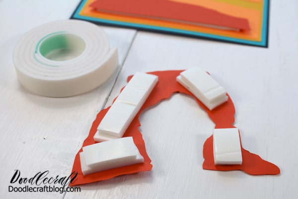 Now, use the foam tape on the top layer of landscape. The added dimension starts bringing this paper craft to life.