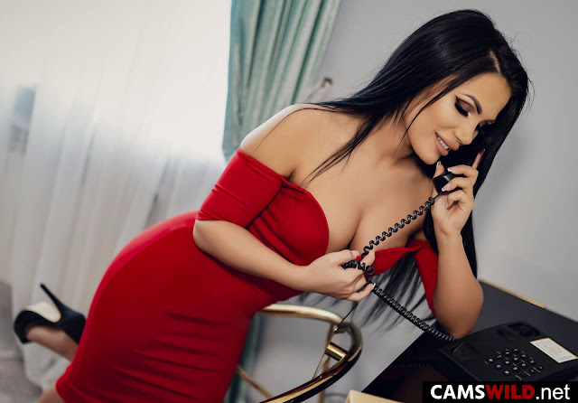 camswild-isabelleshay-black-hair-girl-in-red-midi-dress-talking-on-the-phone