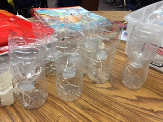 Water bottles for planting seeds.