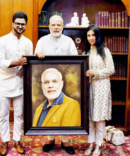 Prime Minister Narendra Modi meets Miniature Artist Suvigya Sharma
