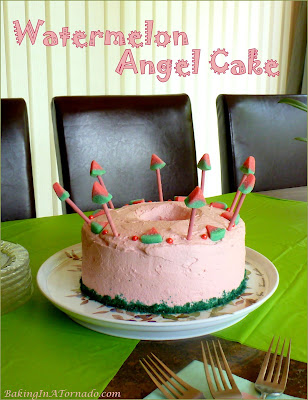 Infused with watermelon flavor this dressed up Watermelon Angel Cake is prefect for any summer occasion. | Recipe developed by www.BakingInATornado.com | #recipe #cake