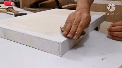 صنفرة معجون قطعة خشبية