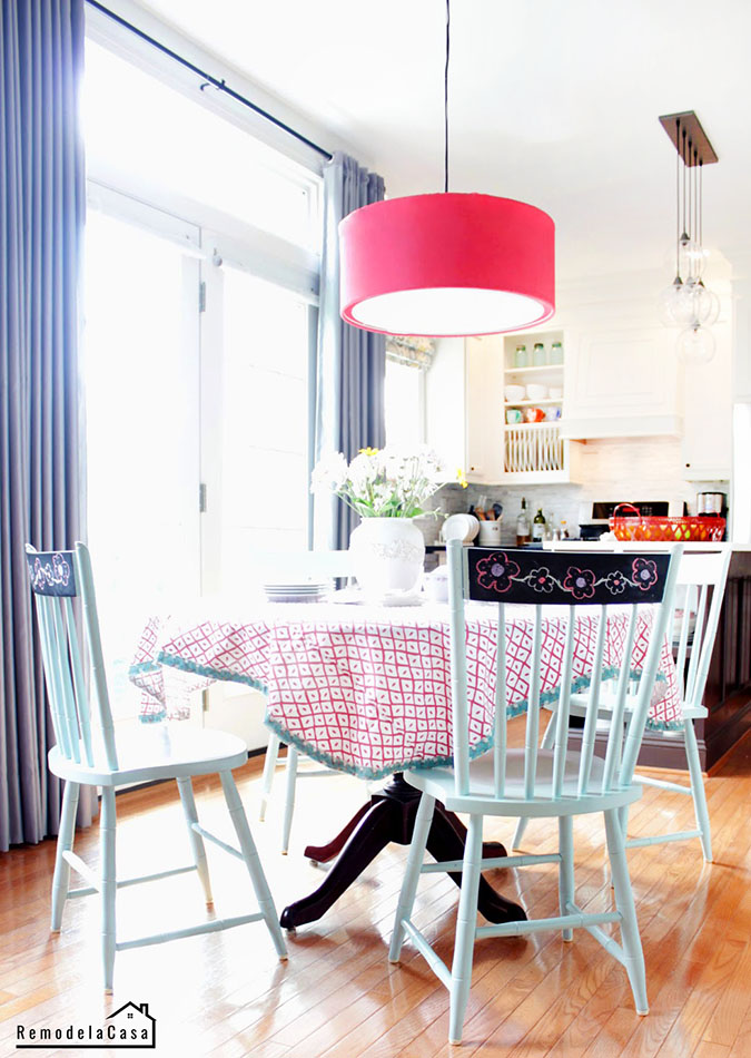 how a breakfast room has evolved, pink drum light, tablecloth on table