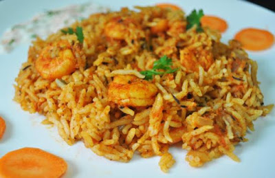 Heat a pan and cook the prawns on low heat till the water is absorbed Spicy Prawn Biryani Recipe