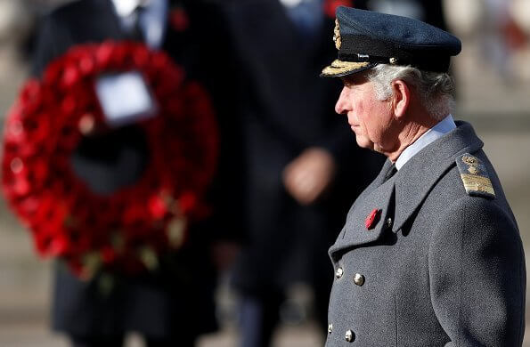 Kate Middleton wore a bespoke black military coat by Alexander McQueen, and a Philip Treacy hat. Queen's diamond and pearl earrings