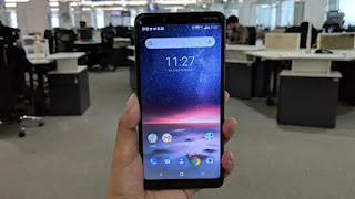 Nokia 3.1 Plus in hand front side display on