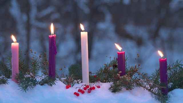 Advent candles in snow