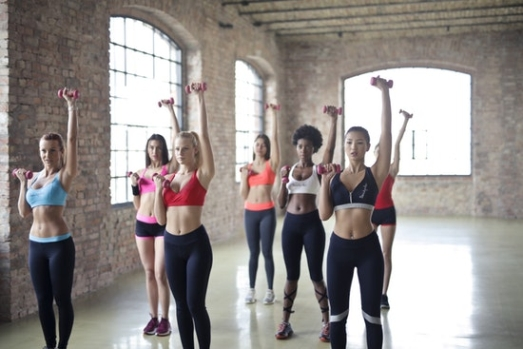 women exercising with dumbells