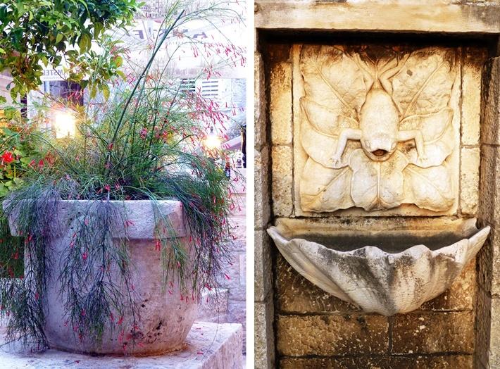 bepflanzter Steintrog und Steinbrunnen