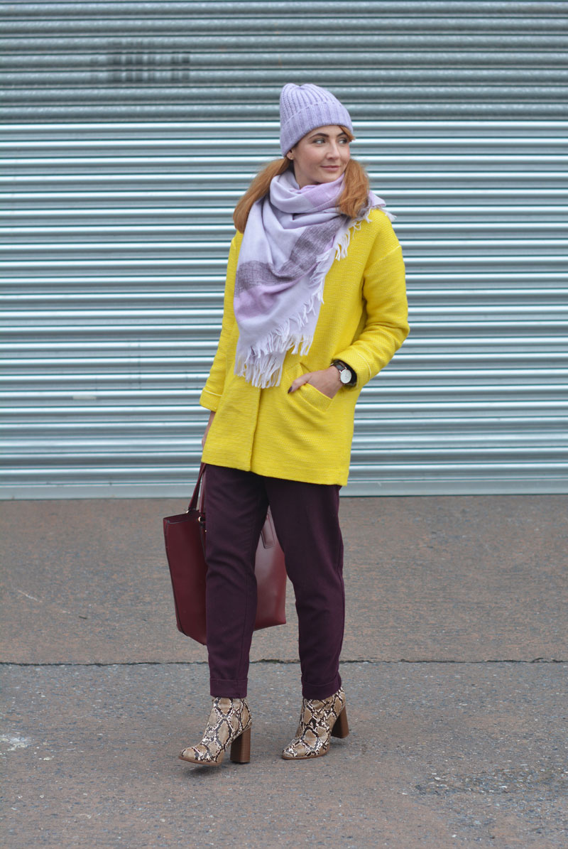Bright winter outfit | Yellow coat, purple trousers, lilac scarf & hat, snakeskin boots
