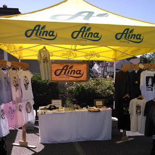 Yellow Aina Clothing tent and eco friendly organic cotton clothing at festival