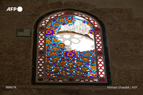 """A window in Al-Aqsa Mosque hit by Israeli forces """"AFP"""""""