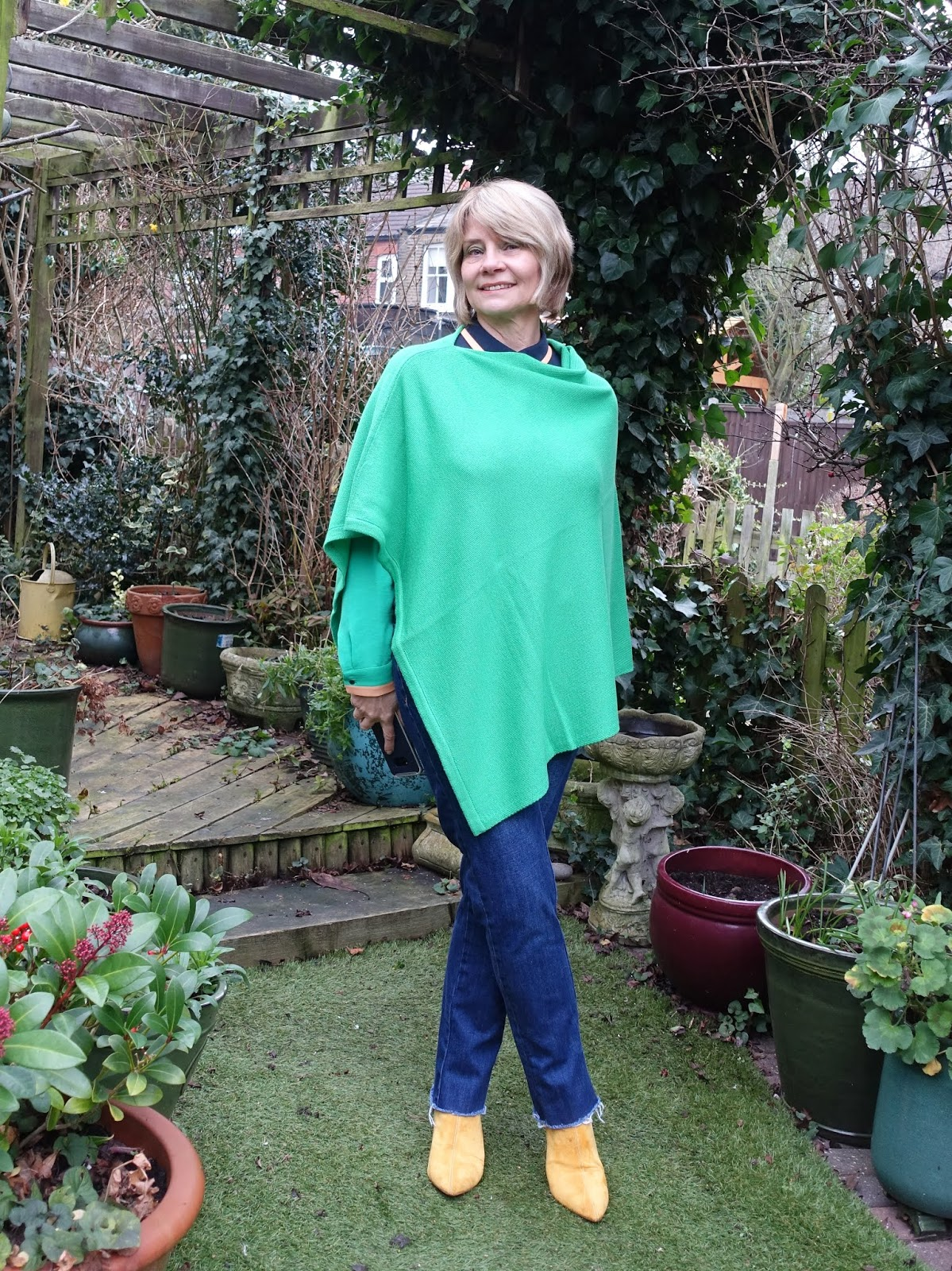 A green poncho for mild weather, worn by over-50s blogger Gail Hanlon