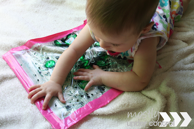 Baby exploring a baby sensory water bag