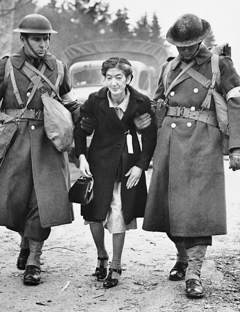 Bainbridge Island resident being taken to the ferry for internment, 30 March 1942. worldwartwo.filminspector.com