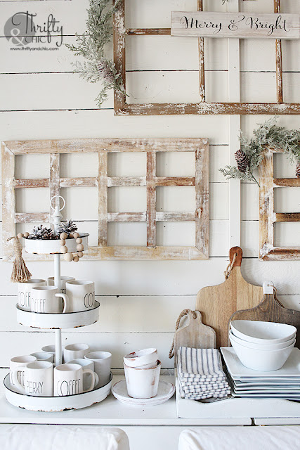 Farmhouse dining room Christmas decor and decorating ideas. Christmas tablescape ideas. Christmas place settings. How to decorate your dining room for Christmas. Dining room wall christmas decor. Dining room with shiplap walls. Neutral christmas dining room decor. Candlestick tablescape.