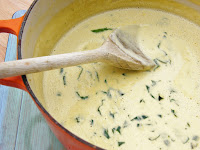 a pot of creamy blue cheese and spinach sauce