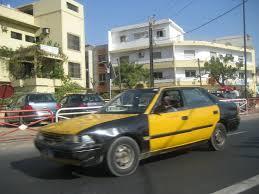 Le taxi sénégalais, la découverte incontournable : Culture, mode, Taxi, transport, urbain, décor, négociation, ville, région, prix, embouteillage, couleur, taximan, LEUKSENEGAL, Dakar, Sénégal, Afrique
